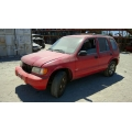 Used 2000 Kia Sportage Parts Car - Red with gray interior, 4cyl engine, 5 speed manual transmission